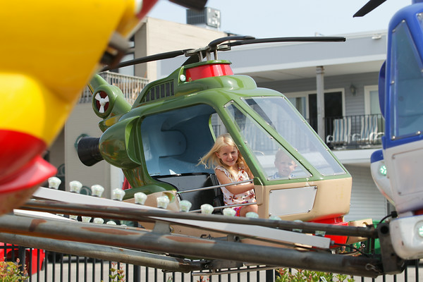 Record-Eagle/Keith King<br /> Nadia Rausch, left, 6, of Beaverton, and her brother, Grant Rausch, 3, enjoy an Arnold Amusements Midway ride during Elk Rapids Harbor Days.