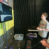 Record-Eagle/Keith King<br /> Austin Bechtel, left, 15, of Haslett, plays a video game with Tyler Summers, audio designer with Michigan State University's GEL (Games for Entertainment and Learning) Lab, at the InsideOut Gallery during the Traverse City Film Festival.