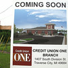 Record-Eagle photos/Glenn Puit<br /> A sign in front of the new Credit Union ONE branch on South Division Street shows what the new structure will look like when complete in October.