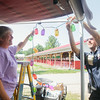 Record-Eagle/Keith King<br /> Nancy Ellis, left, of Elk Rapids, is assisted by Scott Gray, Northwestern Michigan Fair president, as Ellis sets lights up at her campsite and preparations are made for the upcoming Northwestern Michigan Fair in Blair Township.