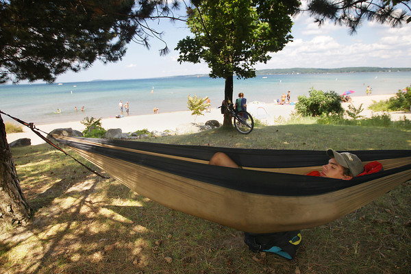 Record-Eagle/Keith King<br /> Sebastian Kucera, of Traverse City, relaxes Monday, July 22, 2013 in a hammock at West End Beach on West Grand Traverse Bay.