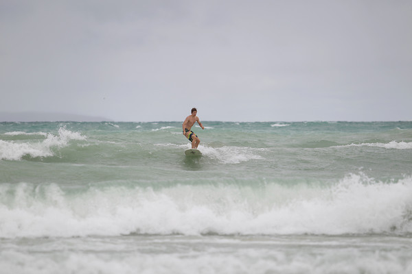 Record-Eagle/Keith King<br /> Keenan May, of Calif. (but grew up in Glen Arbor), surfs Lake Michigan Tuesday, July 23, 2013 near Van's Beach in Leland.