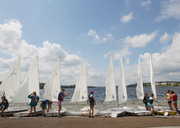 Record-Eagle/Keith King<br /> Students de-rig sailboats after sailing them Friday, July 26, 2013 during a Traverse Area Community Sailing (T.A.C.S.) class on Boardman Lake.