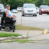 Record-Eagle/Jan-Michael Stump<br /> Rose Bolek says it is hazardous to navigate the sidewalks at Pine and State Streets in her wheelchair from her home at Riverview Terrace.