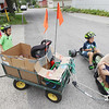 Record-Eagle/Keith King<br /> Jack Lankford, from right, 10, and Drew Cummins, 8, conduct a crash safety test Tuesday, July 31, 2012 as Reese Cummins, 5, and Addison Balentine, far left, 5, all of Traverse City, look on. The group has been trying different techniques throughout the summer to improve upon crash safety,a field that highly interests Lankford, as they use pretend cars.
