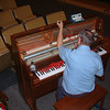 Record-Eagle/Marta Hepler Drahos<br /> <br /> Registered piano technician Jim Cox tunes the piano at the City Opera House in preparation for the Traverse City Film Festival, which starts Tuesday.