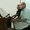 Record-Eagle/Keith King<br /> R. Gary Deavel, right, and the Rev. Kevin Tarsa rehearse a piano duet at the Unitarian Universalist Congregation of Grand Traverse.