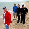 Record-Eagle/Jan-Michael Stump<br /> From left, Ron Smelzter; James Banasiak, of the Benzonia Fire Department; and Benzie EMS paramedics Lenny Merrill and Craig Johnson were among those who helped save a New Jersey man from drowning in Lake Michigan near Lower Herring Lake.