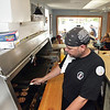 Record-Eagle/Keith King<br /> Manager Chad Canter cooks Saturday at the Harbor Cafe in downtown Elk Rapids.