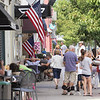 Record-Eagle/Keith King<br /> Pedestrians gather and travel in downtown Elk Rapids on Saturday.
