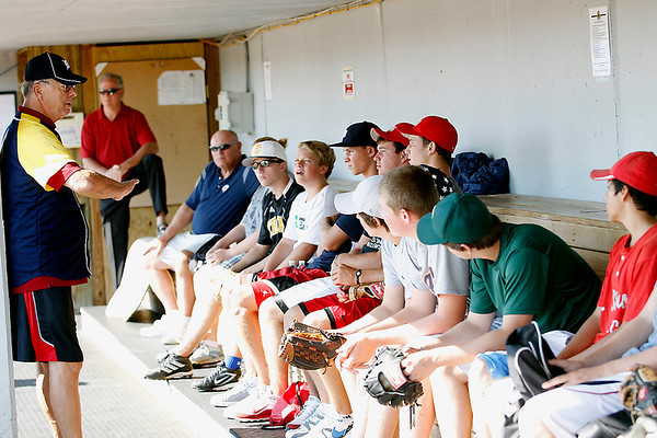 Record-Eagle/Jan-Michael Stump<br /> Former Detroit Tigers pitcher Tom Timmerman, left, talks to players in the dugout at Wuerfel Park during Friday's Legends for Youth Baseball Clinic. The free clinic, for players ages 6-16, featured over a dozen former Major League Baseball players teaching skills. The event was part of a Major League Baseball Players Alumni Association fundraiser for the Dick Mattern Scholarship Fund at Northwestern Michigan College for a student who embodies the character and strength of the school's former baseball coach.
