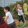 Record-Eagle/Keith King<br /> Zachary Finkel, 3, sprays his neighbor Jakob Hechtman, 4, both of Traverse City, as the two use a hose to cool off and to have fun.