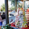 Record-Eagle/Jan-Michael Stump<br /> Movie theater snack-inspired dresses, such as this one made from candy boxes by Ginelle Dekker, sit on display in the window of What To Wear in downtown Traverse City.