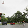 Record-Eagle/Keith King<br /> Jacob Hawley, 8, of Traverse City, runs with his kite as his father, Bob Hawley, stands near Immaculate Conception Catholic Church in Traverse City.