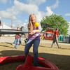 Record-Eagle/Keith King<br /> Katie Risselade, 14, of Traverse City, bats a ball during the National Cherry Festival Special Kids Day.
