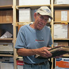 Record-Eagle/Michelle Merlin<br /> Chuck Raney pulls old Elmwood Township records from the township's archive. Raney, the township buildings and grounds supervisor, is in charge of keeping the archive.