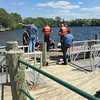 Record-Eagle/Matt Troutman<br /> Grand Traverse County sheriff's deputies gather on a pier near the Hull Park boat launch on Boardman Lake during a search for a missing boater Saturday afternoon.