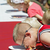 Record-Eagle/Keith King<br /> Cole Matejka, 7, of Illinois, participates in the National Cherry Festival Kids' Cherry Pie Eating Contest at F & M Park.