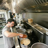 Record-Eagle/Keith King<br /> Dustin Thomas, cook, stirs chili as he prepares food at Villa Marine Food and Spirits in Frankfort.
