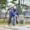 Record-Eagle/Keith King<br /> Richard Willsey competes in the National Cherry Festival Seniors' Shuffleboard Tournament at the Traverse City Senior Center.