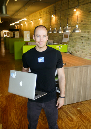 Record-Eagle/Keith King<br /> Joel Mueller, founder of MacUpdate, in the Space co-working space in downtown Traverse City.