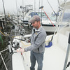 Record-Eagle/Keith King<br /> Dave James, owner of Fish Hunter Charters, in Frankfort, explains the fishing equipment and lures he uses.