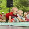 Record-Eagle/Keith King<br /> Clayton Sedlacek, 1, of Kingsley, crawls toward the finish line during the Diaper Derby at F & M Park during the National Cherry Festival.