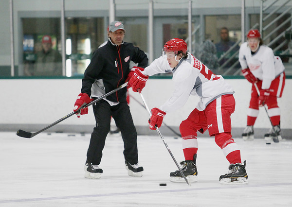 Record-Eagle/Keith King<br /> Tyler Bertuzzi skates as Chris Chelios looks on Wednesday, July 10, 2013 during the Detroit Red Wings skill development camp at Centre ICE in Traverse City.