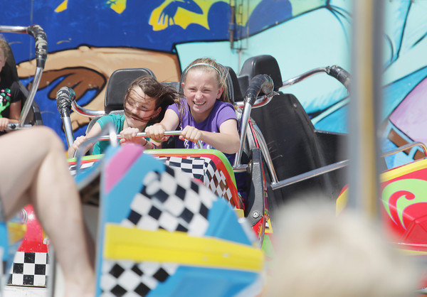 Record-Eagle/Keith King<br /> Olivia Fairbank, left, 12, and Lera Kelley, 12, both of Traverse City, hang on in the Crazy Dance ride Friday, July 5, 2013 at the Arnold Amusements Midway during the 87th National Cherry Festival.