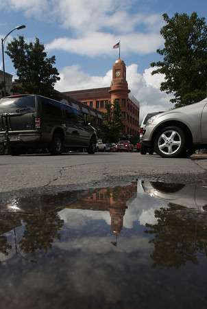 Record-Eagle/Keith King<br /> The Fifth Third Bank Northern Michigan building is reflected in a puddle as traffic travels on Union Street Monday, July 8, 2013 after rain fell through the area.