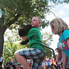 Record-Eagle/Keith King<br /> Keagen Hengesbach, 7, of Kingsley, carries his cat, Big D, near friend Emme Gleason, 7, of Kingsley, toward the judges Tuesday during the National Cherry Festival Kids' Pet Show fat cat contest at F&M Park in Traverse City. Big D weighs approximately 15 pounds and two ounces.