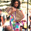 Record-Eagle/Keith King<br /> Ava Serrano, 7, of Traverse City, holds Petunia, her Flemish giant rabbit, during the National Cherry Festival Kids' Pet Show at F&M Park in Traverse City.