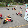 Record-Eagle/Keith King<br /> Participants take some laps Saturday prior to the start of the National Cherry Festival Kids' Big Wheel Race at the Grand Traverse County Civic Center.