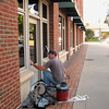 Record-Eagle/Jodee Taylor<br /> Dave Kantlehner, of Northern Michigan Glass, puts the finishing touches on the front door to the Traverse City Film Festival box office, 125 Park St.