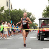 Record-Eagle/Jan-Michael Stump<br /> Zach Ripley wins the men's 15k during Saturday's National Cherry Festival's Festival of Races.