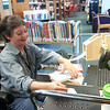 Record-Eagle/Jodee Taylor<br /> Kim Ross tags books in Youth Services with an RFID (radio frequency identification) sticker at the Traverse Area District Library.