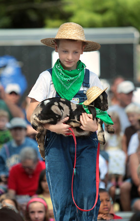 Record-Eagle/Keith King<br /> Lucas Shaffer, 10, of Kingsley, holds Sweet Pea, a Nubian goat, from the Rusty Pines Ranch during the National Cherry Festival Kids' Pet Show at F&M Park in Traverse City.