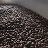 Record-Eagle/Keith King<br /> Coffee beans lie in a bin after being roasted and prior to being bagged at Higher Grounds Trading Company in Traverse City.