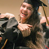 Record-Eagle/Keith King<br /> Nicole O'Brien smiles during the presentation of diplomas during the Traverse City Central High School commencement at the Interlochen Center for the Arts.