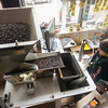 Record-Eagle/Keith King<br /> Sara Theisen bags coffee beans at Higher Grounds Trading Company in Traverse City.