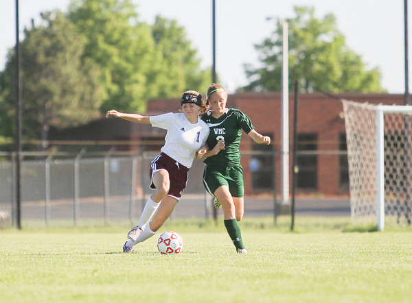 Record-Eagle/Keith King<br /> Charlevoix's Kylee Scholten (1), left, and Western Michigan Christian's Taylor Denison (9), battle for the ball at the Coast Guard Soccer Complex in Traverse City.