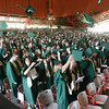 Record-Eagle/Keith King<br /> Graduates throw their caps in the air at the conclusion of the Traverse City West Senior High School commencement at the Interlochen Center for the Arts.