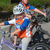 Record-Eagle/Marta Hepler Drahos<br /> William Haapala, 10, and Karoline Haapala, 7, wait for the start of a TC Rides community bike ride.