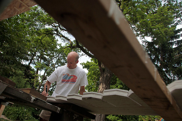 Record-Eagle/Jan-Michael Stump<br /> Joe Winowiecki paints siding for his Fifth Street home on Thursday afternoon.
