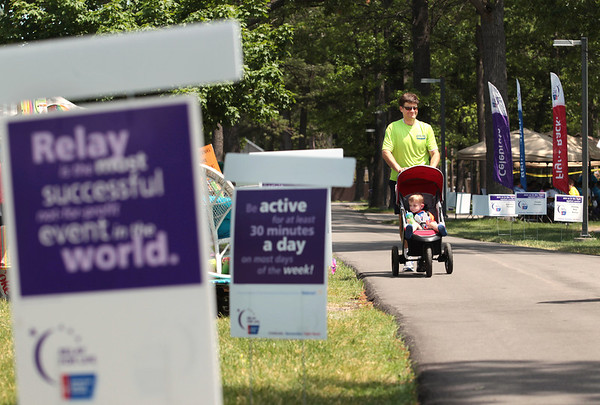 Record-Eagle/Keith King<br /> Bart Ford, of Traverse City, walks with his son Fletcher, 20 months, at the Grand Traverse County Civic Center Saturday during the Relay for Life of Grand Traverse County. The event concludes today.
