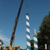 Record-Eagle/Keith King<br /> The top section of a steel utility pole between Bay Street and Grandview Parkway is removed Wednesday in Traverse City.
