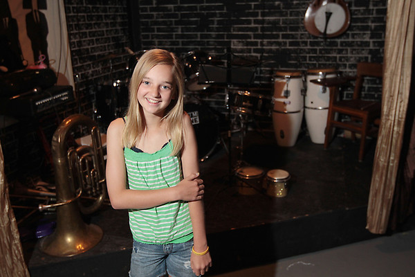 Record-Eagle/Keith King<br /> Jenna Elsenheimer, 12, of Traverse City, poses Tuesday for a photograph near a stage in the basement of her family's home.