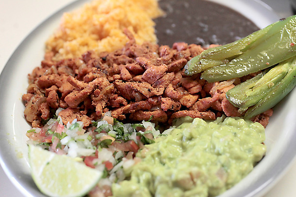 Record-Eagle/Jan-Michael Stump<br /> Roasted pork entree at Osorio Tacos Y Salsas in Acme.