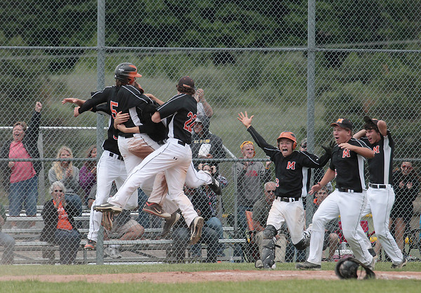 Record-Eagle/Keith King<br /> Mancelona celebrates after scoring the game-winning run against Newaygo on Tuesday.