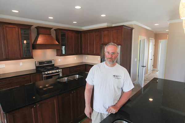 Record-Eagle/Keith King<br /> Greg Schultz stands in the kitchen of a house built by Schultz Construction and Remodeling, on Old Mission Peninsula, that is planned to be in the 2014 Parade of Homes.